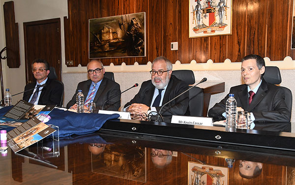 Dr Mario Vella, Governor Central Bank of Malta, flanked by officials from the Bank